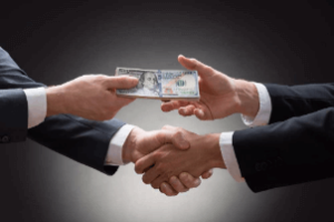 public corruption with simple handshake and money